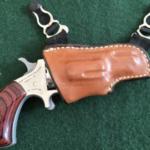 gun in a holster hanging from a garter